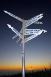 Buller-District;Buller-Region;Cape-Foulwind;Cape-Foulwind-Walkway;direction-sign;direction-signs;distance-sign;distance-signs;dusk;evening;N.Z.;New-York-12749-km;New-Zealand;nightfall;NZ;orange;place-sign;place-signs;Rio-De-Janeiro-11080-km;S.I.;SI;sign;signs;sky;South-Is;South-Island;sunset;sunsets;twilight;Vancouver-10391-km;West-Coast;Westland
