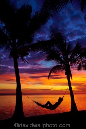 coast;coastal;coastline;coastlines;coasts;coconut-palm;coconut-palm-tree;coconut-palm-trees;coconut-palms;Coral-Coast;dusk;evening;female;Fij;Fiji-Islands;foreshore;hammock;hammocks;Korotogo;nightfall;ocean;orange;Pacific;Pacific-Ocean;palm;palm-tree;palm-trees;palms;sea;shore;shoreline;shorelines;shores;Sigatoka;silhouette;silhouettes;sky;South-Pacific;sunset;sunsets;tropical-island;tropical-islands;twilight;Viti-Levu;Viti-Levu-Island;water;woman;women