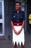 guard;guarding;stand;standing;uniform;black;white;shirt;belt;police;policeman;policemen;police-officer;officer;patrol;lava-lava;doorway;policing-;cop