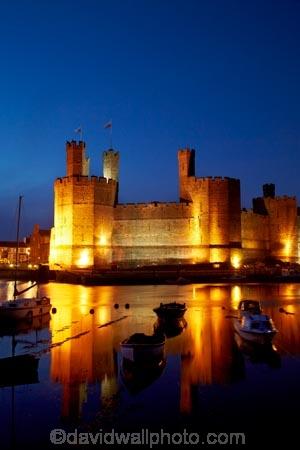 Afon-Seiont;battlement;battlements;boat;boats;Britain;British-Isles;building;buildings;Caernarfon;Caernarfon-Castle;calm;Carnarvon;Carnarvon-Castle;Castell-Caernarfon;castellated;castellations;castle;castles;crenellation;crenellations;Cymru;dark;dusk;Dymar-dre;evening;flood-lighting;flood-lights;flood-lit;flood_lighting;flood_lights;flood_lit;floodlighting;floodlights;floodlit;fort;fortification;fortress;fortresses;G.B.;GB;Great-Britain;Gwynedd;heritage;historic;historic-building;historic-buildings;historical;historical-building;historical-buildings;history;light;lights;medieval-castle;medieval-castles;night;night-time;night_time;old;placid;quiet;reflection;reflections;River-Seiont;serene;smooth;still;stone-buidling;stone-building;stone-buildings;tradition;traditional;tranquil;twilight;U.K.;UK;UN-world-heritage-site;UNESCO-World-Heritage-Site;United-Kingdom;united-nations-world-heritage-site;Wales;water;Welsh-Castle;Welsh-Castles;Welsh-Flag;Welsh-flags;world-heritage;World-Heritage-Park;World-Heritage-site;World-Heritage-Sites