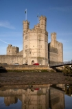 Afon-Seiont;battlement;battlements;Britain;British-Isles;building;buildings;Caernarfon;Caernarfon-Castle;calm;Carnarvon;Carnarvon-Castle;Castell-Caernarfon;castellated;castellations;castle;castles;crenellation;crenellations;Cymru;Dymar-dre;fort;fortification;fortress;fortresses;G.B.;GB;Great-Britain;Gwynedd;heritage;historic;historic-building;historic-buildings;historical;historical-building;historical-buildings;history;medieval-castle;medieval-castles;old;placid;quiet;reflection;reflections;River-Seiont;serene;smooth;still;stone-buidling;stone-building;stone-buildings;tradition;traditional;tranquil;U.K.;UK;UN-world-heritage-site;UNESCO-World-Heritage-Site;United-Kingdom;united-nations-world-heritage-site;Wales;water;Welsh-Castle;Welsh-Castles;Welsh-Flag;Welsh-flags;world-heritage;World-Heritage-Park;World-Heritage-site;World-Heritage-Sites